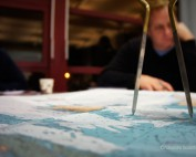 The intellectual sailor reading maritime charts with compass